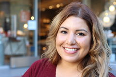 Portrait of a young Hispanic female smiling Royalty Free Stock Images