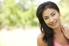 Portrait Of Young Hispanic Woman In Park Royalty Free Stock Photography