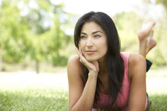 Portrait Of Young Hispanic Woman In Park Stock Images