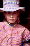 Portrait of a young Hmong woman flowers. Can Cau market, this young woman who came to shop. It tests the sharpness of the chopper it wants to buy. She was gone Royalty Free Stock Photography