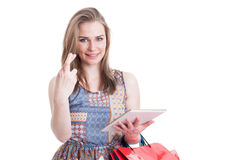 Portrait of young hopeful shopper holding fingers crossed Royalty Free Stock Image