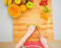 Portrait of young housewife making fruits salad Stock Image