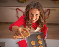 Portrait of young housewife showing christmas cookies Royalty Free Stock Images