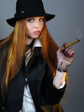 Portrait of the young impudent woman with a cigar Stock Photos