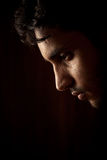 Portrait of young Indian angry man over dark Royalty Free Stock Photos