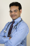 Portrait of young indian doctor. Smiling Royalty Free Stock Photography