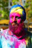 Portrait of young Indian man colored face during Holi festival near Pune Stock Photos