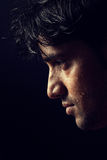 Portrait of young Indian  man over dark Stock Image