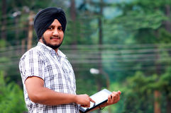 Portrait of a young indian Sikh with tablet Stock Image