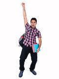 Portrait of young Indian student jumping with joy. Portrait of young Indian student jumping with joy, isolated on white background Royalty Free Stock Photography