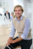 Portrait of young instructor smiling. Portrait of young instructor in business class Royalty Free Stock Image