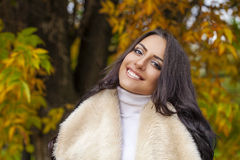 Portrait of young Italians in beige coat Royalty Free Stock Photos
