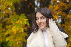 Portrait of young Italians in beige coat Royalty Free Stock Photography