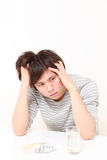 Portrait of young Japanese man suffers from a neurosis. Studio shot of young Japanese man on white background Royalty Free Stock Photography