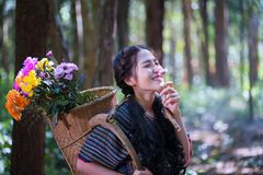 Portrait young karen women smiled hand hole flower and flower ba Royalty Free Stock Photo