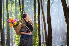 Portrait young karen women smiled hand hole flower and flower ba Royalty Free Stock Image