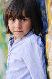 Portrait of boy next to wall Royalty Free Stock Photography