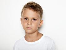 Portrait of young kid wearing white tshirt Royalty Free Stock Images