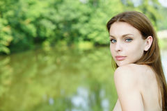 Portrait of young lady. Portrait of young fair-haired naked lady at summer green park royalty free stock images