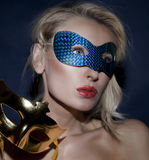 Portrait of young lady in carnival mask. Stock Image