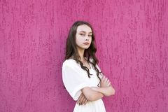 Portrait of young lady with crossed arms royalty free stock photography