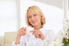 Portrait of young lady with a cup Stock Photo