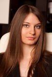 Portrait of the young lady with green eyes. Royalty Free Stock Image
