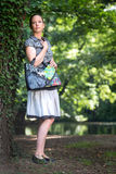 Portrait of young lady with handbag Royalty Free Stock Photography