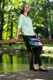 Portrait of young lady with handbag Stock Photography