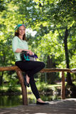 Portrait of young lady with handbag Stock Photo