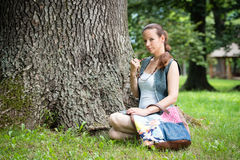Portrait of young lady with handbag Royalty Free Stock Photo