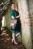 Portrait of young lady with handbag Stock Photos
