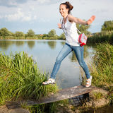 Portrait of young lady with lake in background Royalty Free Stock Image