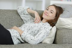 Portrait young lady relaxing on sofa Royalty Free Stock Images