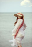 Portrait of young lady by the sea Stock Images