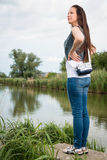 Portrait of young lady standing by the lake Royalty Free Stock Photos