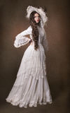 Portrait of a young lady in a white hat. Poriret beautiful girl in a white dress Royalty Free Stock Photo