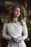 Portrait of a young lady in a white vintage dress Royalty Free Stock Photo