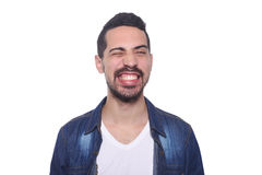 Portrait of a young latin man against white background. Portrait of a young latin man smiling.  white background Stock Photo