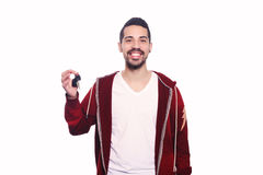 Portrait of young latin man holding car keys. Stock Image
