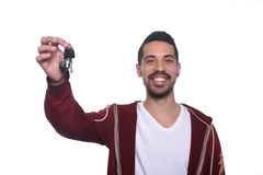 Portrait of young latin man holding car keys. Royalty Free Stock Photography