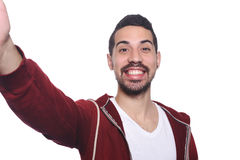 Portrait of young latin man taking selfie. Royalty Free Stock Image