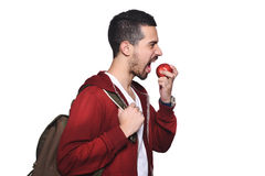 Portrait of young latin student with an apple and backpack . Portrait of young latin student with an apple and backpack. Isolated white background Stock Photo