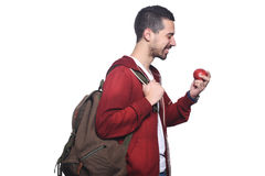Portrait of young latin student with an apple and backpack . Portrait of young latin student with an apple and backpack. Isolated white background Royalty Free Stock Photo