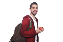 Portrait of young latin student with an apple and backpack . Portrait of young latin student with an apple and backpack. Isolated white background Stock Image