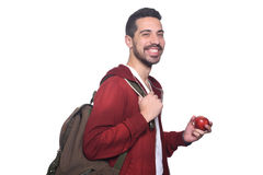 Portrait of young latin student with an apple and backpack . Portrait of young latin student with an apple and backpack. Isolated white background Stock Photos