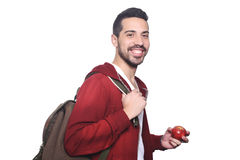 Portrait of young latin student with an apple and backpack . Portrait of young latin student with an apple and backpack. Isolated white background Royalty Free Stock Images