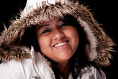 Portrait of a young latin woman with a furry hood Royalty Free Stock Photos