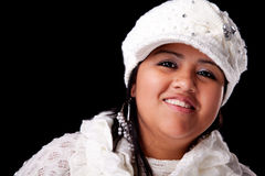 Portrait of a young latin woman smiling. In autumn/winter clothes, isolated on white. Studio shot Stock Photos