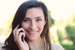 Young woman talking on her mobile phone. Royalty Free Stock Images